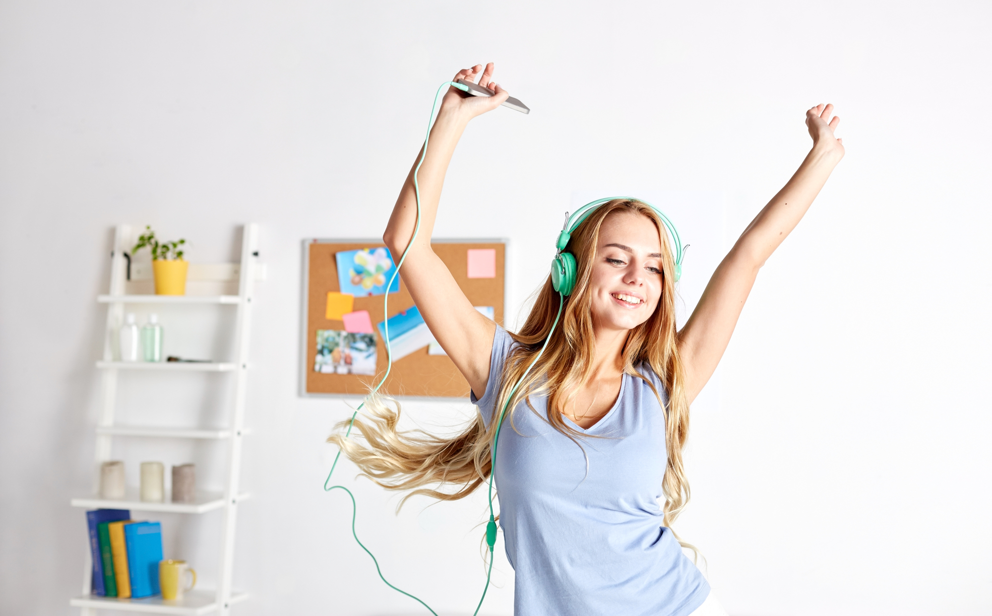 teen dancing in a room