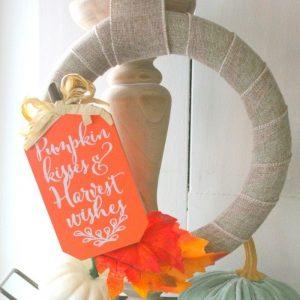 wreath hanging from a candlestick pillar