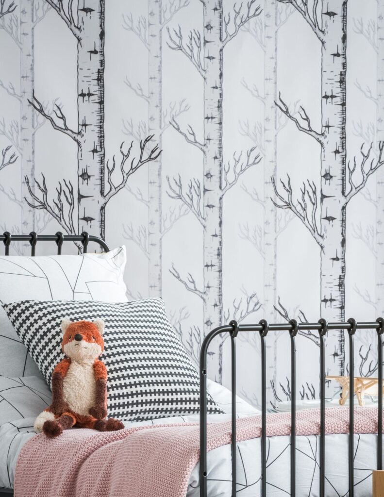 child's bedroom with trees on wall