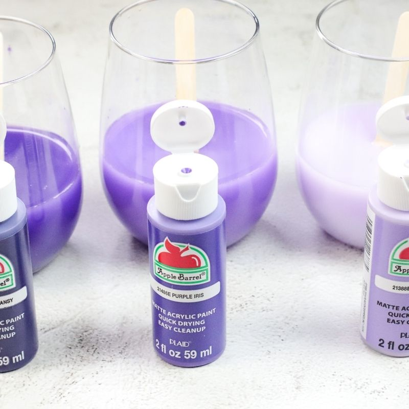 painting cups with purple paint in them