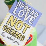 cleaner with a gift tag that says spread love not germs
