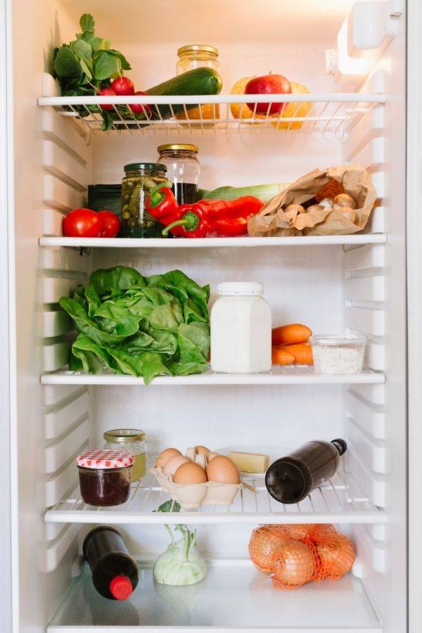 inside of a refrigerator with food in it